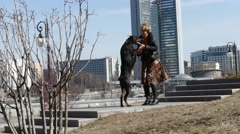 Woman playing with her doberman dog outdoors Stock Footage