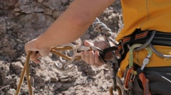 Rock climber wearing safety harness and climbing equipment Stock Footage