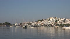 4K Famous Greek town old harbour Skiathos Island fishing boat ship anchor emblem - stock footage