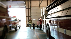 Fire Fighter With His Little Boy In Fire Station - stock footage