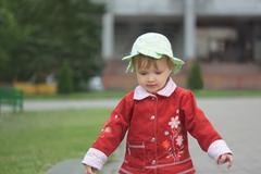 Little girl walking outdoors Stock Photos