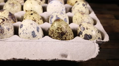 Quail eggs on wooden background Stock Footage