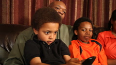 Family watching TV - stock footage