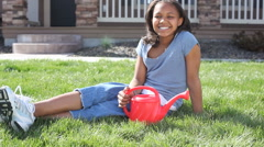Girl with watering can Stock Footage