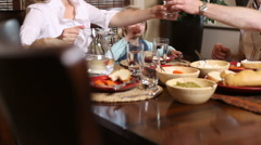 family eating at dinner table - stock footage