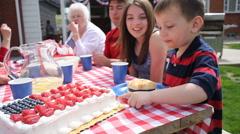 Boy tastes cake and smiles Stock Footage