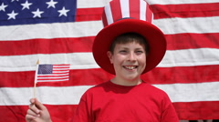 Boy waving American flag Stock Footage