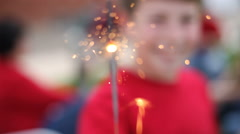 Boy holding sparkler - stock footage