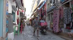 4K Narrow commercial road souvenir shop local boutique Skiathos Island town day  Stock Footage