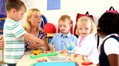 Teacher with preschool kids Stock Footage