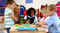 Preschool kids and teacher Stock Footage
