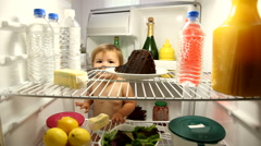 Mother catches baby getting into frig Stock Footage