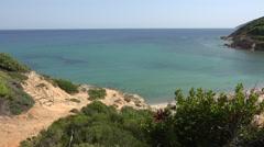 4K Aerial view narrow path sandy stairway isolated beach Skiathos Island emblem Stock Footage
