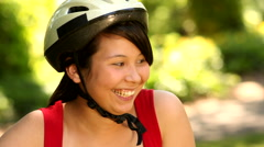 Portrait of teenage girl with bicycle and helmet Stock Footage