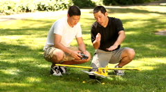 Father and son with model airplane Stock Footage