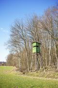 Hunting pulpit at the edge of a forest in spring. Stock Photos