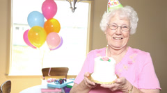 Smiling grandma with cake Stock Footage