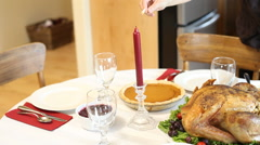 Lighting candles for Thanksgiving dinner Stock Footage