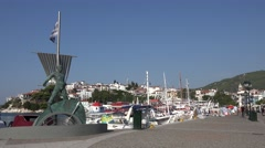4K Skiathos monument people walk city promenade old harbour yacht anchor emblem  Stock Footage
