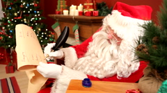 Santa Claus writing on list Stock Footage
