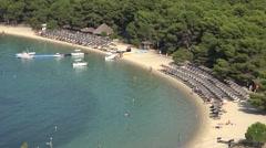 4K Tourist people relax famous Koukounaries sandy beach Skiathos Island emblem  Stock Footage