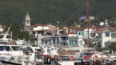 4K Crowded Skiathos downtown old port boat anchor harbour summer holiday iconic  Stock Footage