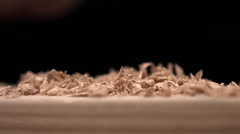 Hand brusing off wood shavings, slow motion Stock Footage