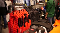 Interior of a fashionable clothes store in a big mall - shopping Stock Footage
