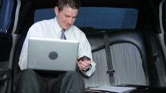 Businessman working in a limo - stock footage