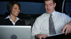 Businesspeople meet in limo - stock footage