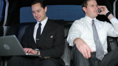 Two businessmen in limo - stock footage