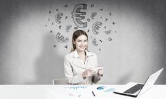 Preparing her financial report - stock photo