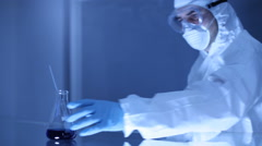 Scientist looking into vial - stock footage