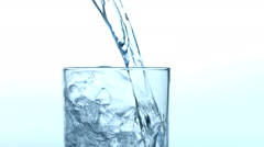 Pouring glass of water closeup Stock Footage