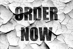 Grunge cracked Order now sign - stock illustration