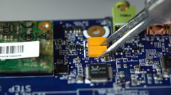 Electronics repair. soldering microchips and circuit boards Stock Footage