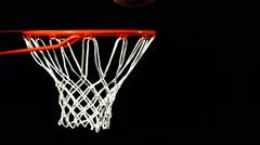 Basketball falls through hoop, slow motion Stock Footage