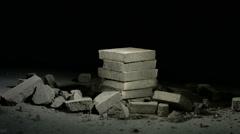 Sledge hammer hitting concrete bricks Stock Footage