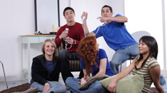 Group of teens play video game Stock Footage