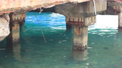 old concrete pier at the seaside - stock footage