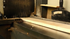 Woodshop. View of bar moves along conveyor belt Stock Footage