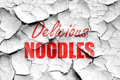 Grunge cracked Delicious noodles sign - stock illustration