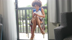 Hipster African American girl sending text message on mobile phone - vacation - stock footage