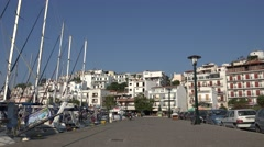 4K Touristic cityscape old harbour Skiathos Island traffic street white building Stock Footage