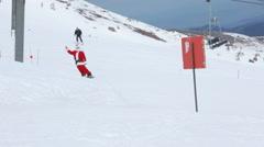Santa Claus rides snowboard - stock footage