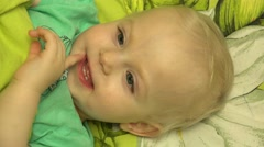 Father  Tickle his Baby in Bed. Closeup - stock footage