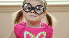 Young girl playing with silly glasses Stock Footage