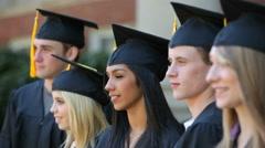 Graduates move tassels Stock Footage