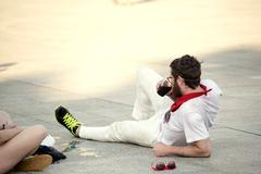 Spain Navarra Pamplona 10 July 2015 S Firmino fiesta a boy lying on the sidew - stock photo
