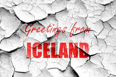 Grunge cracked Greetings from iceland - stock illustration